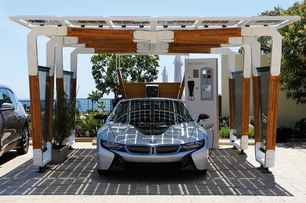 BMW i8 using electric car charging point with solar